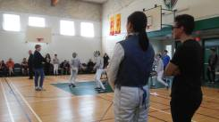coaching advice at a fencing tournament
